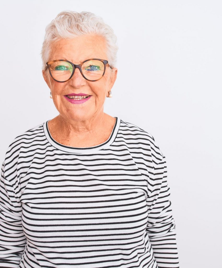 Senior grey-haired woman wearing striped navy t-shirt glasses over isolated white background with a happy and cool smile on face. Lucky person.